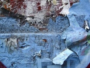 6371280-old-brick-wall-with-graffiti-and-parts-of-old-posters-peeling-off
